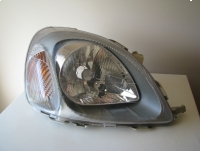 Oryginalny przedni prawy reflektor - lampa Toyota Yaris 1999/2003